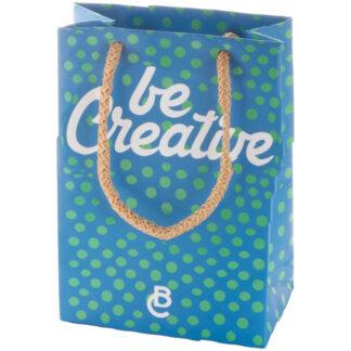 blå papperskasse med gröna prickar med polypropenhandtag