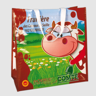 En Wovenkasse med tryck i form av en ko och gräs